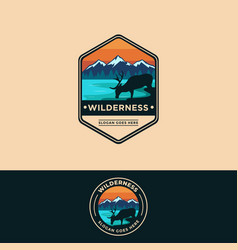 Wilderness deer on lake mountain landscape logo vector
