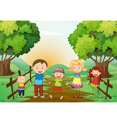 A happy family standing at the pathway vector image