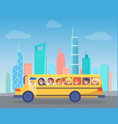 School bus full of children drives through city vector