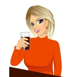 young girl holding drink glass vector image