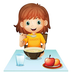 A little girl eating her breakfast vector image vector image