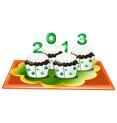 Four chocolate cupcakes for 2013 vector