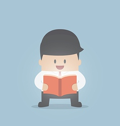 Businessman reading the shining book vector image
