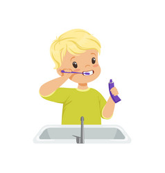 Cute boy brushing his teeth kid caring for teeth vector