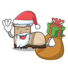 Santa with gift pair working boots in shape vector