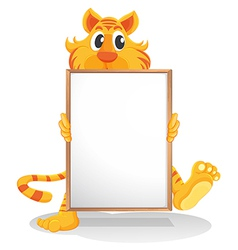 A tiger holding an empty whiteboard vector