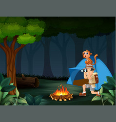 zookeeper boy and his monkey camping in the forest vector image