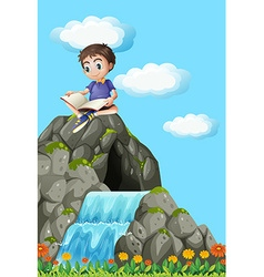 Boy reading book on the rock vector