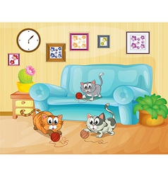Three cats playing inside house vector