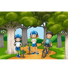 Three kids riding bike in the park vector image