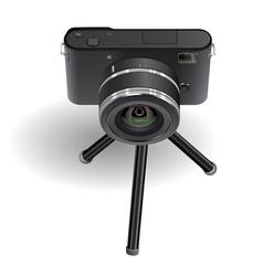 Digital photo camera on small tripod vector