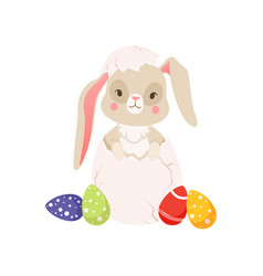 Cute cartoon bunny sitting in cracked easter egg vector