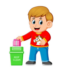 A boy keep clean environment by trush in rubbish vector