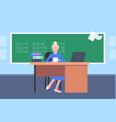 female teacher sitting at desk in front of vector image