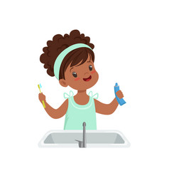 girl holding tooth paste and toothbrush cute kid vector image