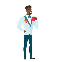 young african-american groom holding cup of coffee vector image