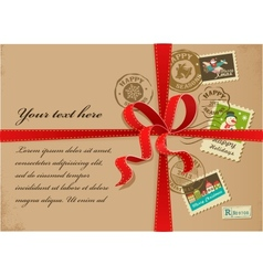 Christmas gift with red ribbon and vintage postage vector image vector image