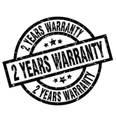 2 years warranty round grunge black stamp vector image