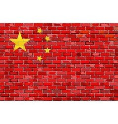Grunge flag of China on a brick wall vector image