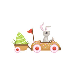 Cute little bunny driving car with green egg vector
