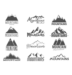 Set hand drawn mountains badges wilderness old vector