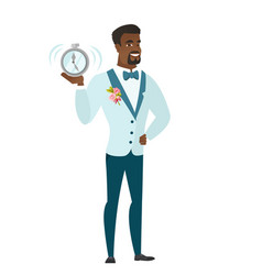 African-american groom holding alarm clock vector