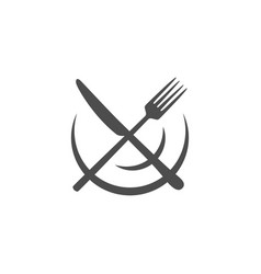 crossed knife over fork that lie on a plate vector image