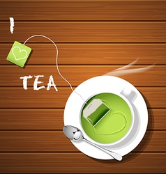 a cup of hot green tea and tea bag with steam vector image