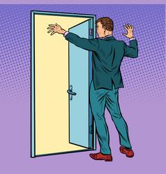 pop art man opens door greeting vector image
