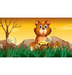 A cute bear holding a pot of honey vector image vector image