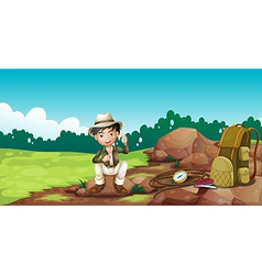 A boy wearing hat sitting on rock vector