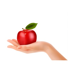 Red ripe apple in a hand Concept of diet vector