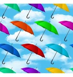 Seamless colorful umbrellas background vector