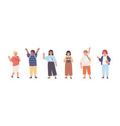set modern schoolchildren waving hands vector image