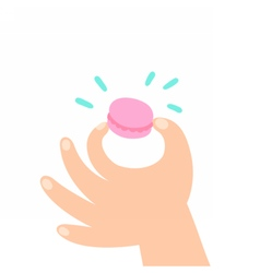 Hand holding macaroon vector