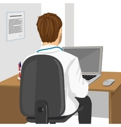 Medical doctor using laptop in clinic vector