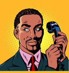 serious african man talking on a retro phone vector image