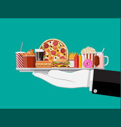 tray with fast food in hand waiter vector image