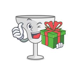 With gift margarita glass mascot cartoon vector