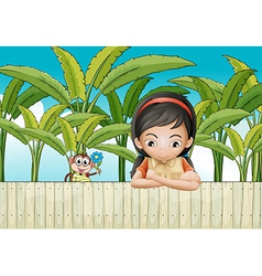 A sad girl leaning over the fence vector image