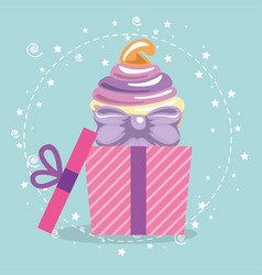 sweet and delicious cupcake with gift vector image vector image