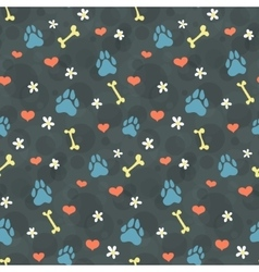Pattern with dogs paw prints vector