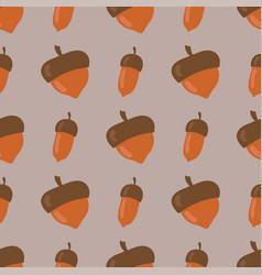 Cute seamless pattern made of brown acorns vector