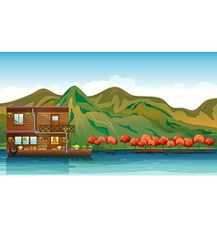 A river and a boat house vector image