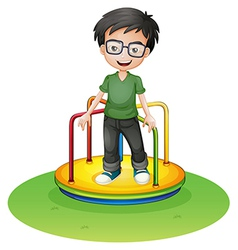 A happy boy above a colorful round ride at the vector image