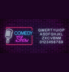 Neon comedy show sign with retro microphone and vector