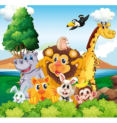 A group of animals near the river vector image