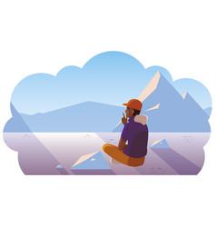 Afro man contemplating horizon in snowscape scene vector