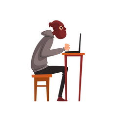 hacker in disguise sitting at desktop and working vector image
