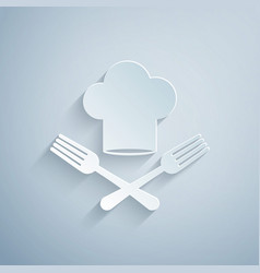 Paper cut chef hat and crossed fork icon isolated vector